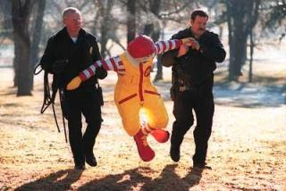 Ronald is repremanded for taking a souvenir picture during a trip to the Keepmoat Stadium