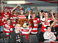 Wally celebrates the 2006 Carling Cup Quarter Final Draw